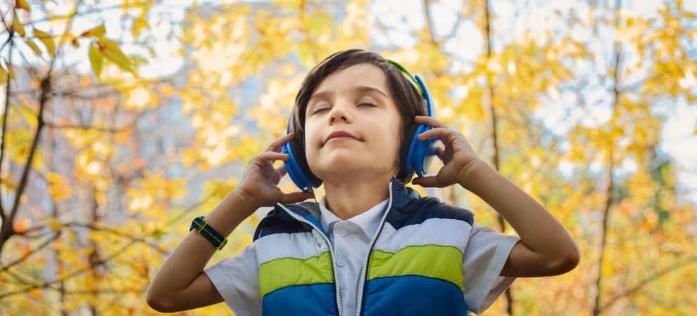 child listening to spanish songs for kids