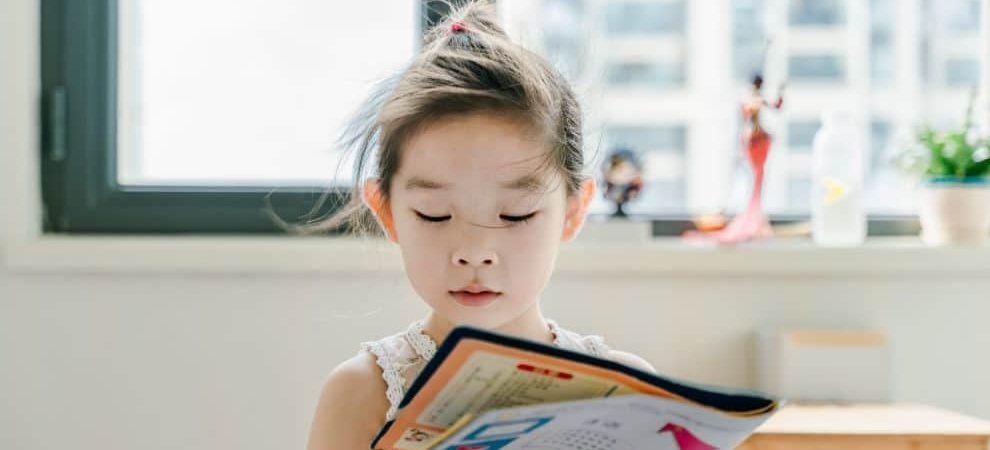 child reading Spanish Book