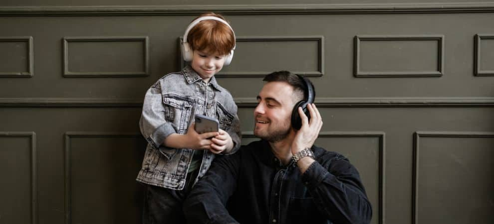 Dad and son listening to Spanish songs for kids